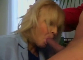 Blonde auntie performs a deep blowjob