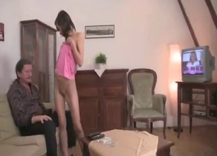 Daddy licks his daughter's shaved snatch on the sofa