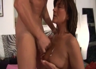 Brunette passionately sucks a dick of her brother